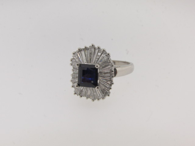 Contemporary Platinum, Diamond and Sapphire Ring/Pendant with a total of 4.40cts