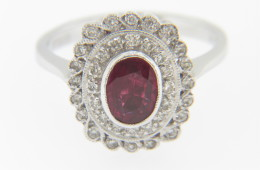 Contemporary 1.20ctw Oval Ruby and Diamond Ring in Platinum Size 6.5