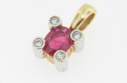 0.49ctw Oval Ruby and Round Diamond Pendant in 14k Yellow Gold