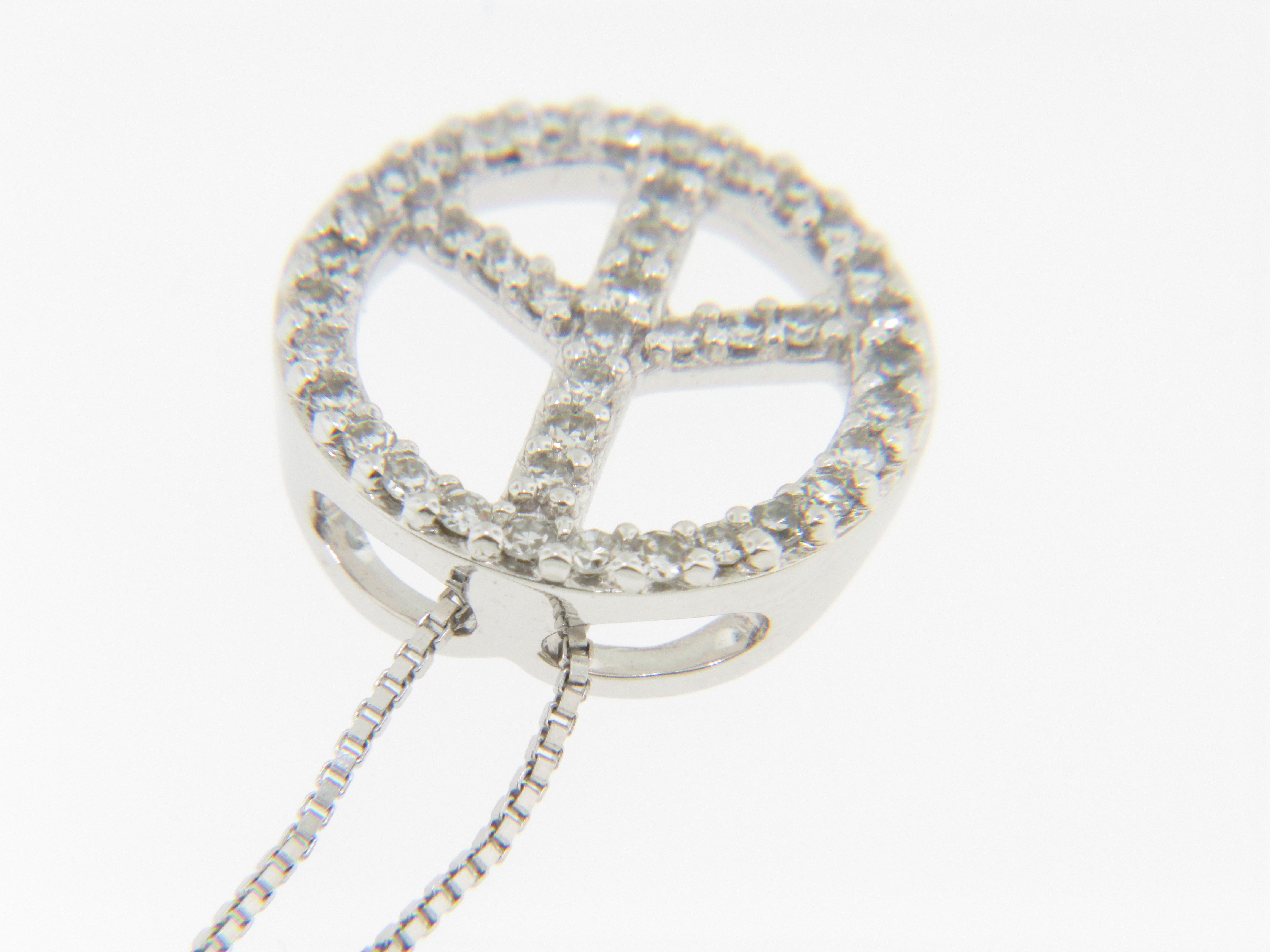 Contemporary 015ct round diamond peace sign pendantnecklace in 14k this lovely pendant features round cut diamonds all over the front side that each measure approx 125mm in diameter for a total diamond carat weight of buycottarizona Gallery