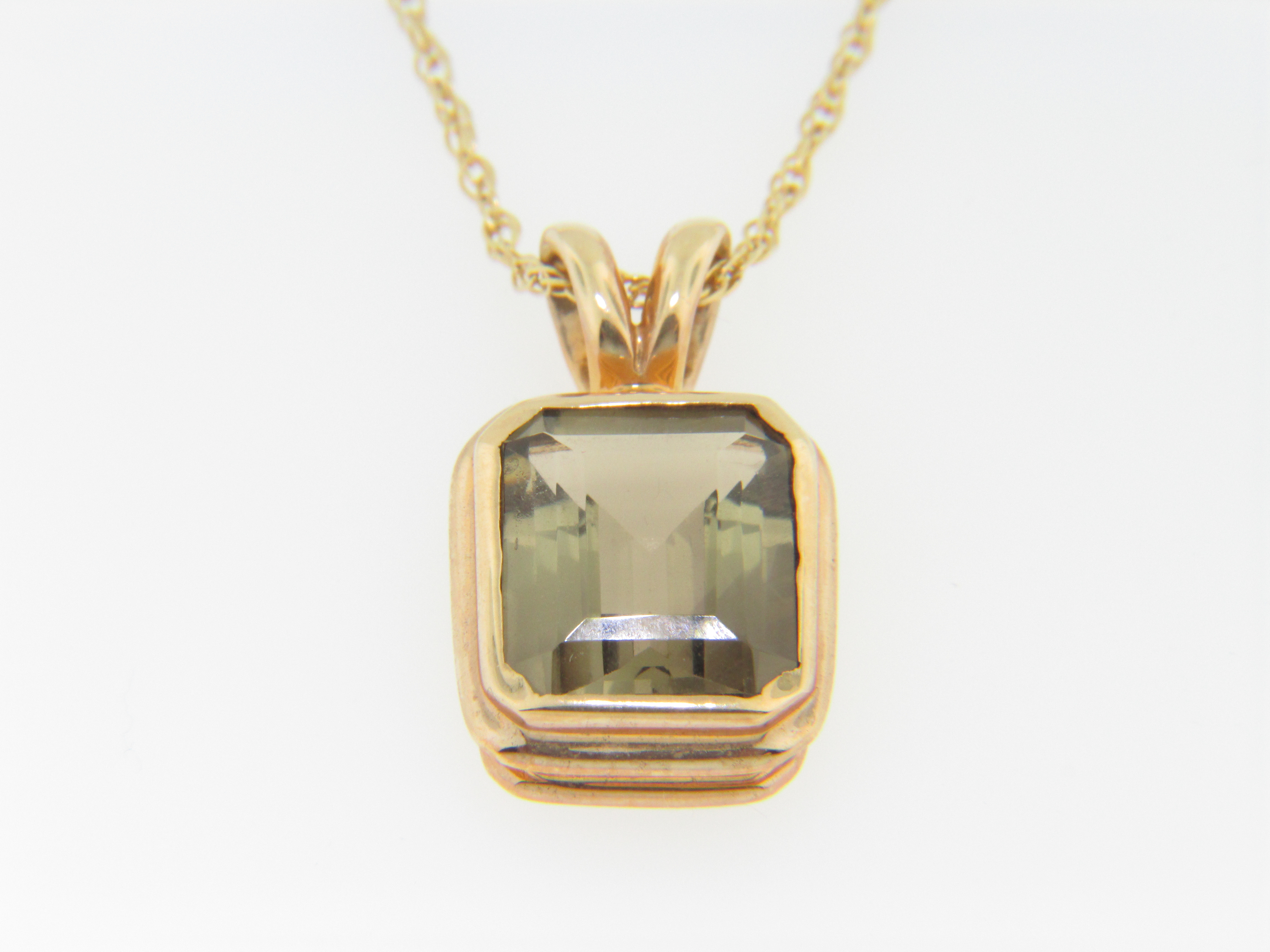 Contemporary emerald cut smokey topaz pendantnecklace in 14k this lovely pendant features an emerald cut bezel set smokey topaz that measures approx 125mm by 105mm a timeless design the price of this necklace is aloadofball Image collections