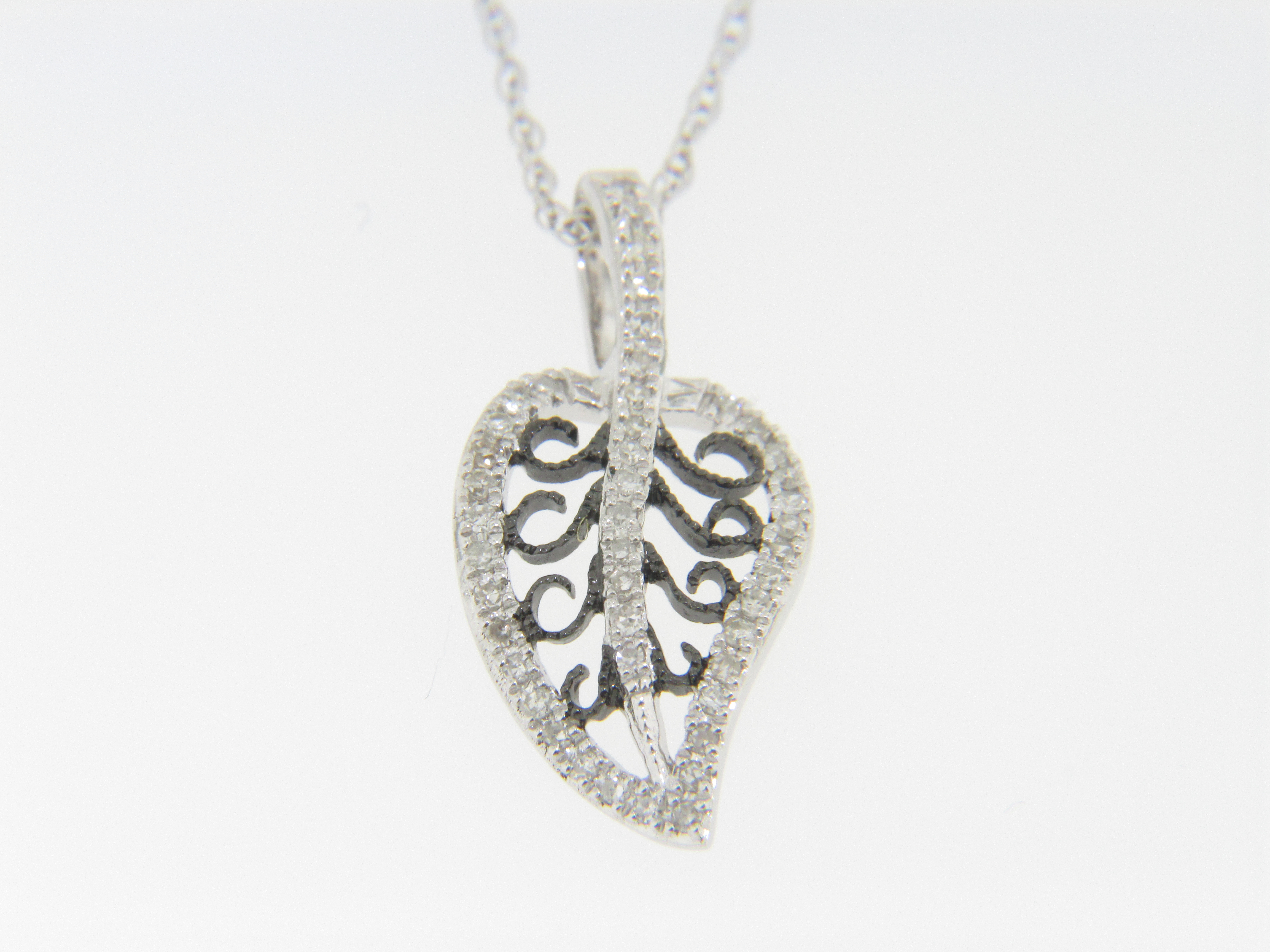 Contemporary Round Diamond & Black Scroll Leaf Necklace in 14k White Gold