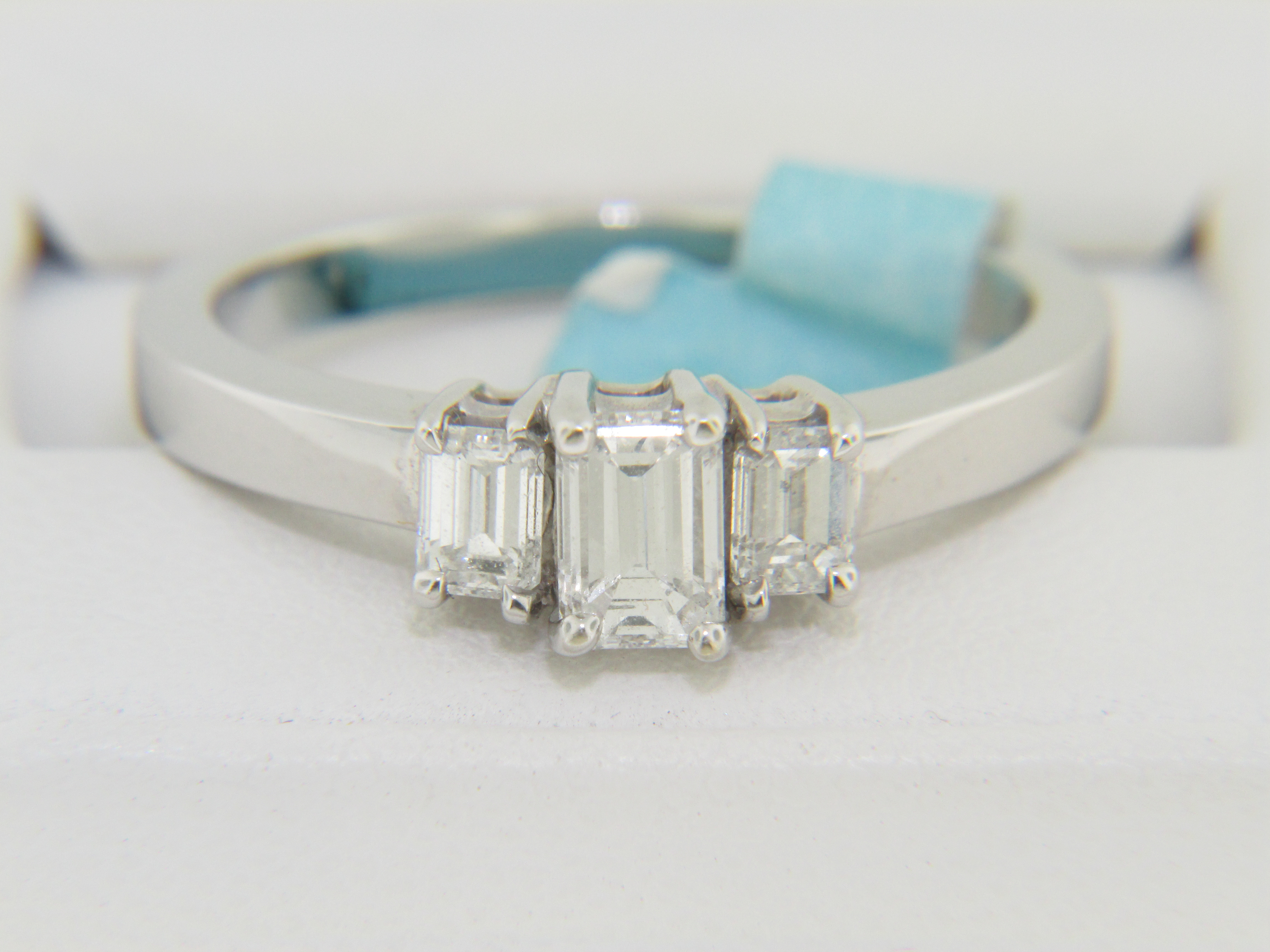 modern 0 69ctw emerald cut engagement ring in 14k