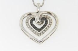 Contemporary 0.50ctw Black & White Diamond Heart Necklace in .925 Sterling Silver