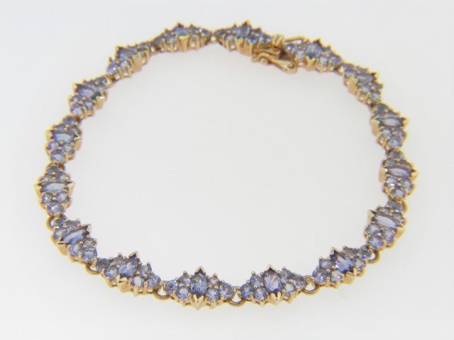 Contemporary Marquise & Round Cut Tanzanite Bracelet in 14k Yellow Gold
