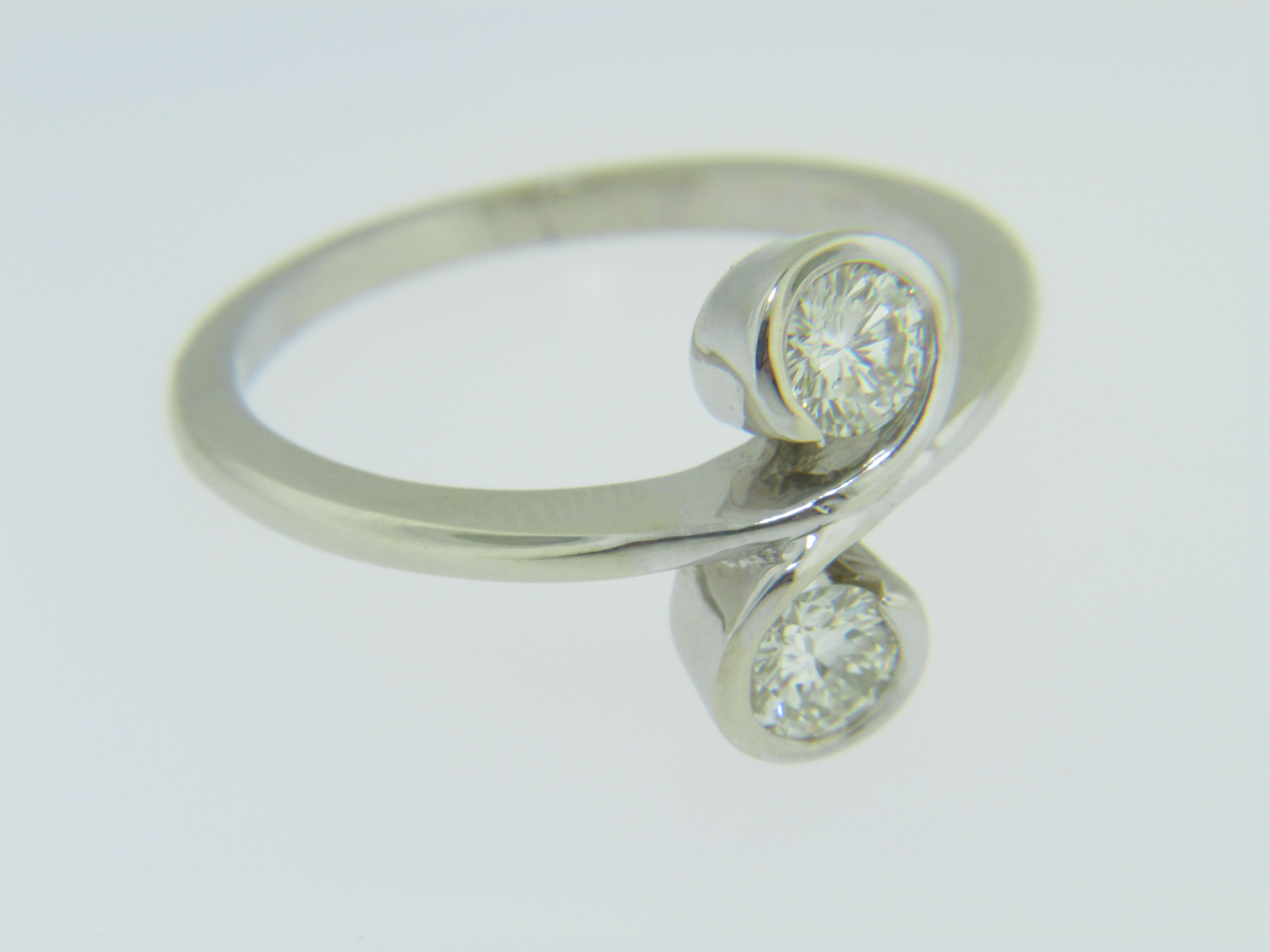 Contemporary 0 50ctw Two Stone Round Diamond Scroll Ring